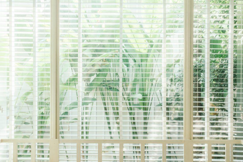 Blinds window decoration in bedroom interior - Vintage Light Filter